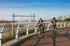 Cyclists on Riverfront Cycle Route - Transporter Bridge